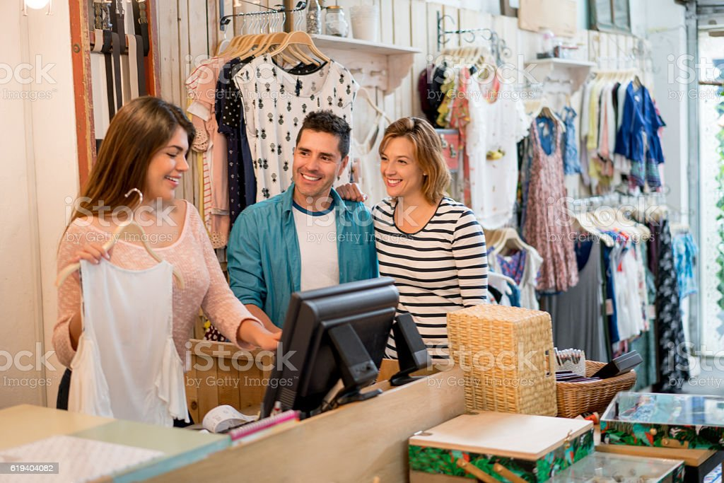Shopping couple paying at the cashier stock photo