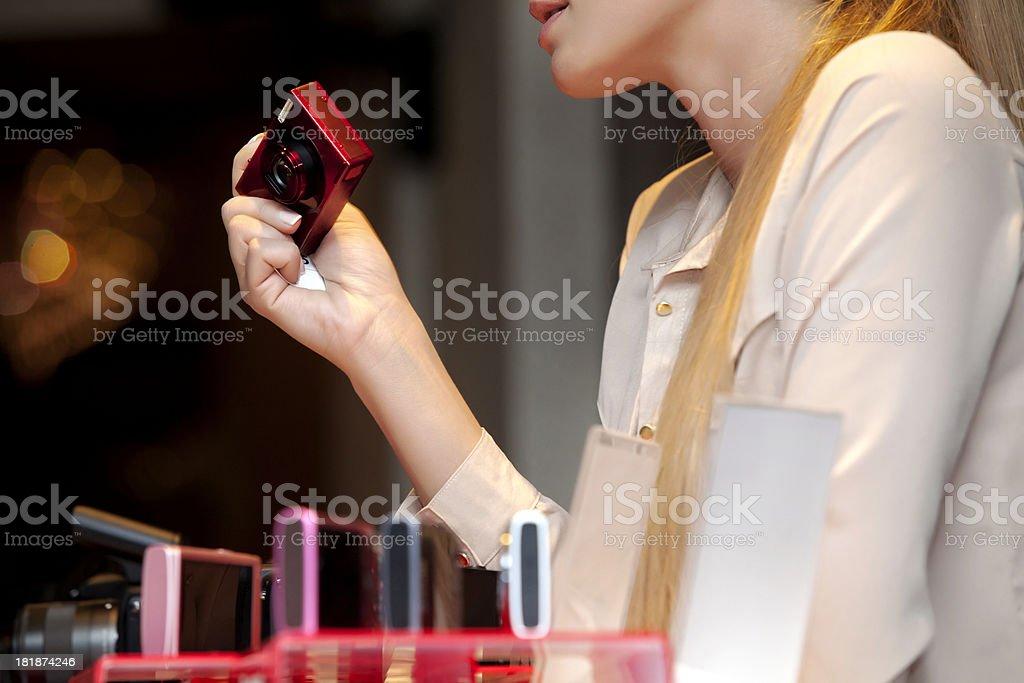 Shopping for digital camera royalty-free stock photo