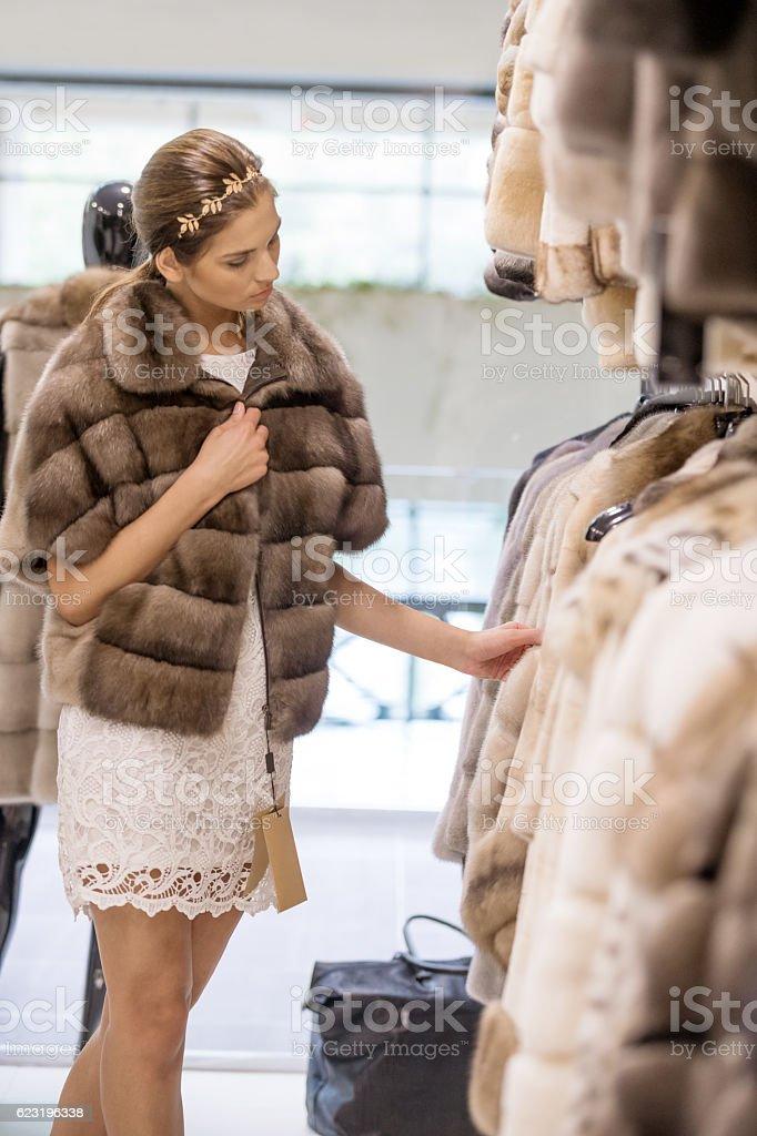 Shopping for fur coat stock photo