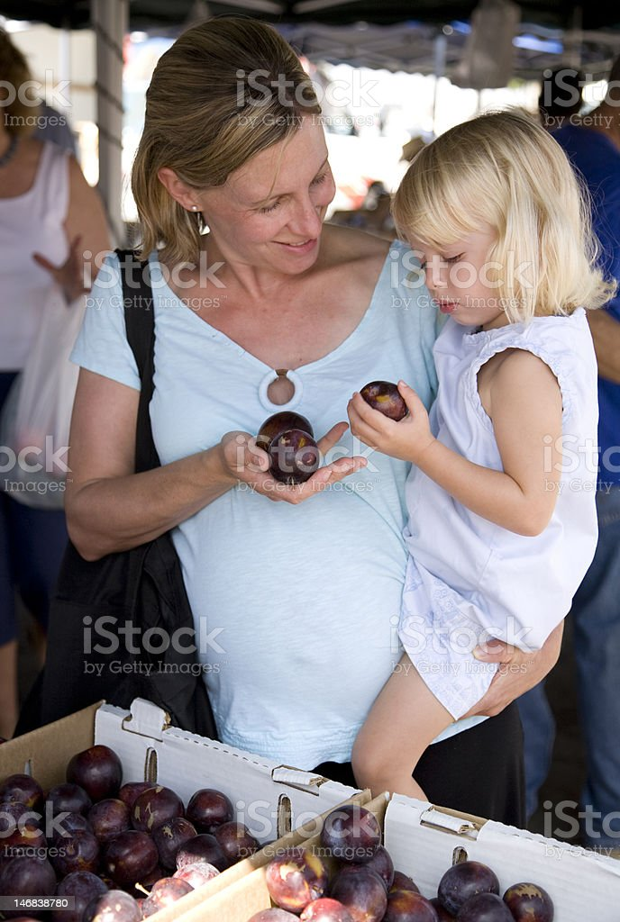 Shopping for plums royalty-free stock photo