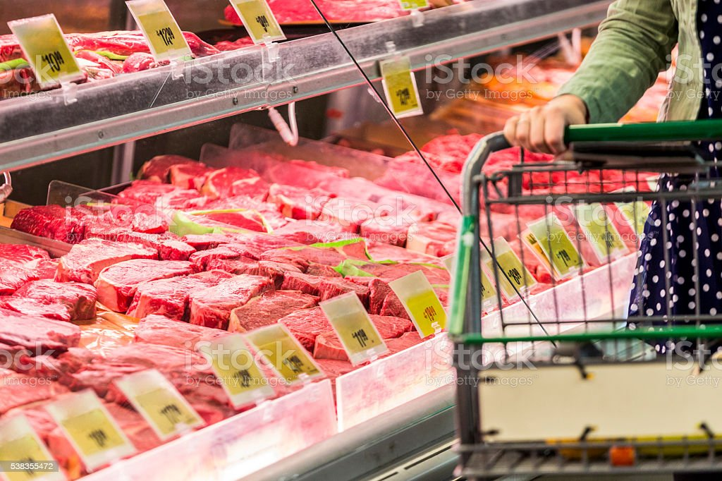 Shopping for raw red meat stock photo