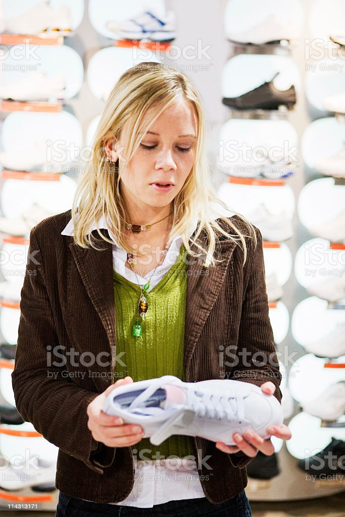 Shopping for sports shoes royalty-free stock photo