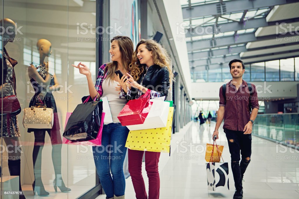 Shopping girls are looking dresses in the Mall stock photo