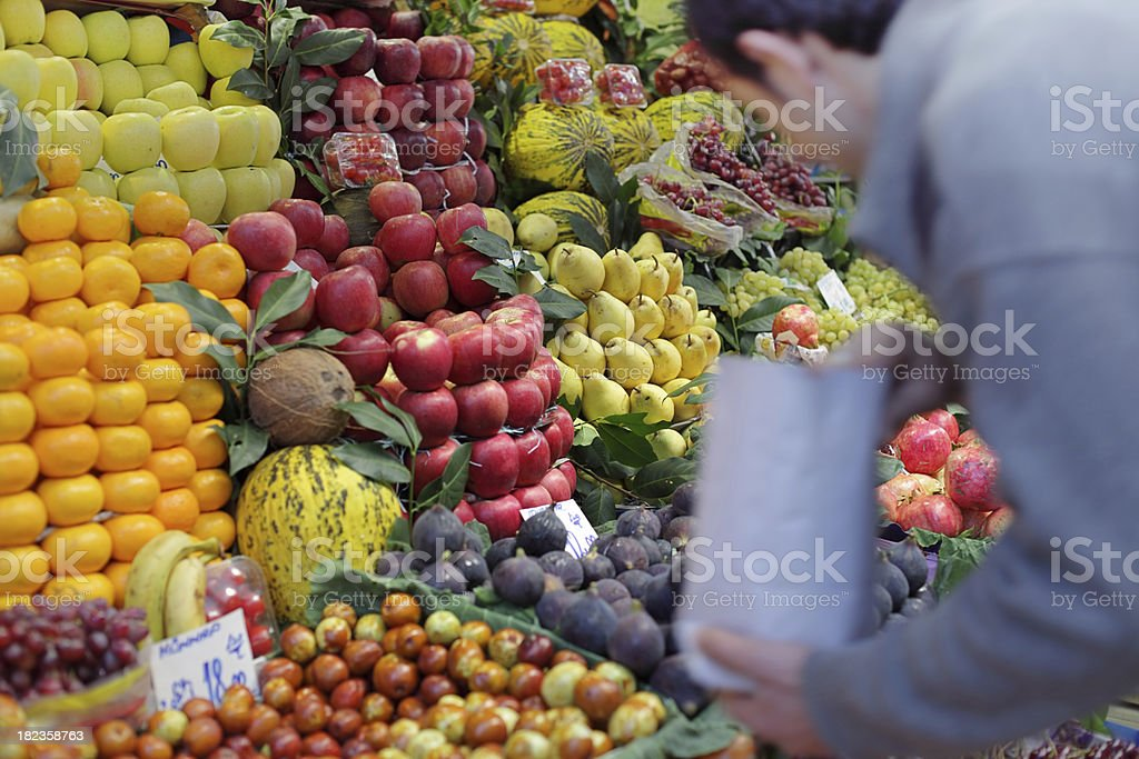 Shopping in a Greengrocer's Shop, Istanbul, Turkey royalty-free stock photo