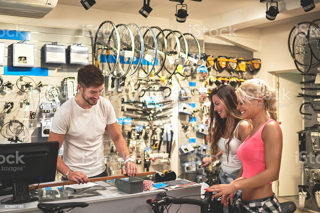 Shopping in bicycle store stock photo