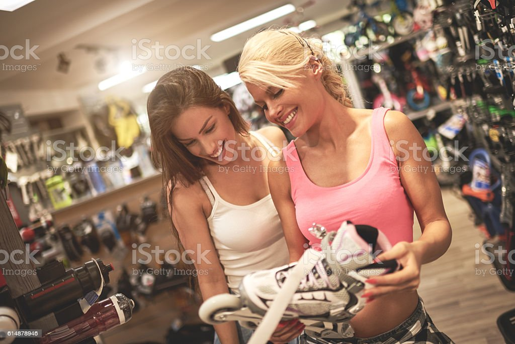 Shopping in sports store stock photo
