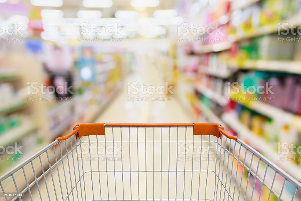 shopping in supermarket with shopping cart stock photo