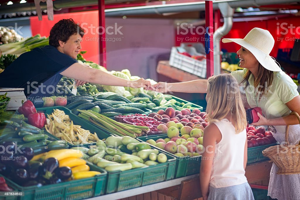 Shopping in vegetable market stock photo