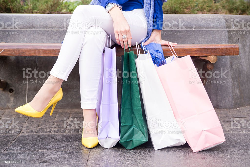 Shopping legs - shopping bags and crossed legs stock photo
