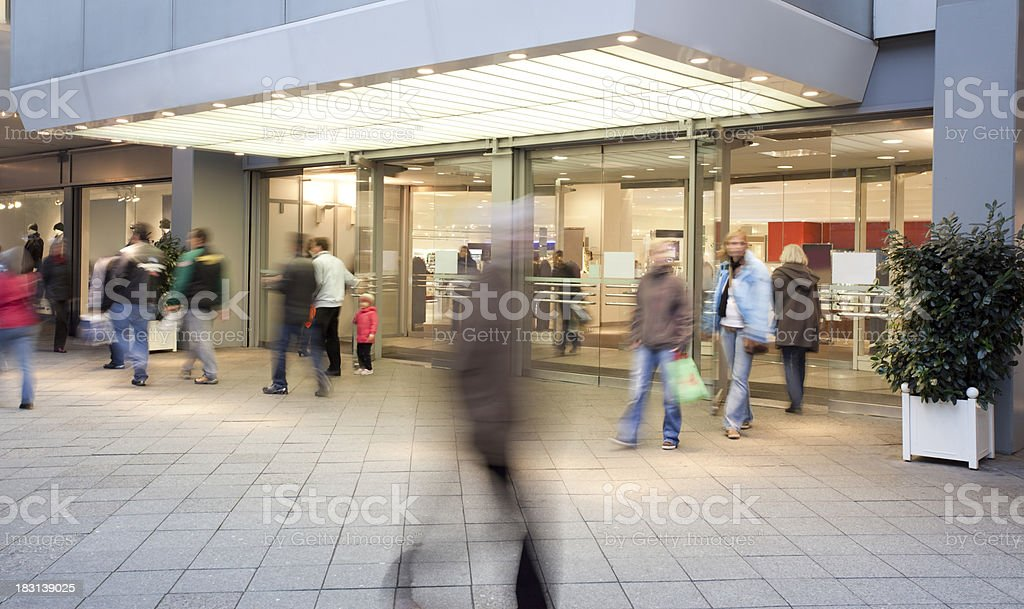 Shopping Mall Entrance with People Walking stock photo