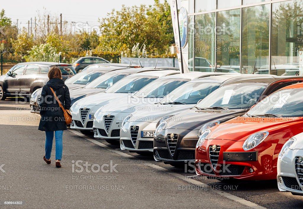 Shopping new car woman choosing car in a row stock photo