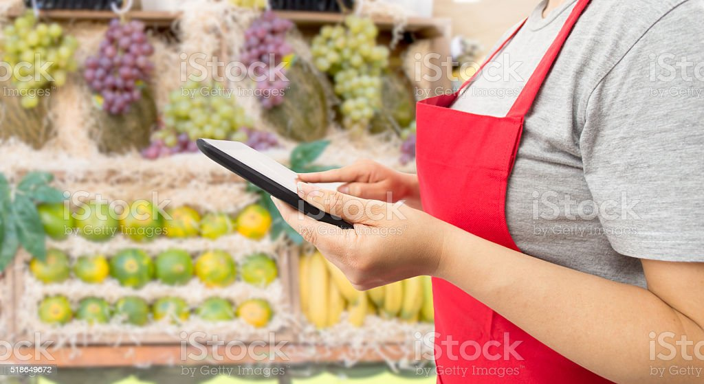 shopping online the fruits with a digital tablet stock photo