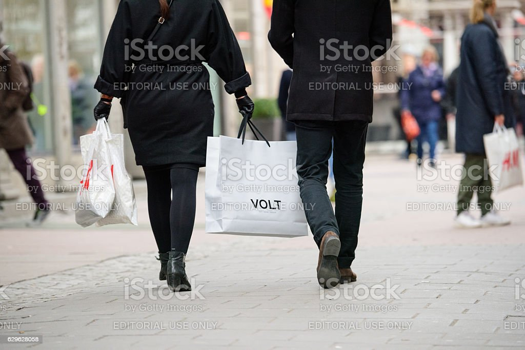 Shopping people with bags on street stock photo