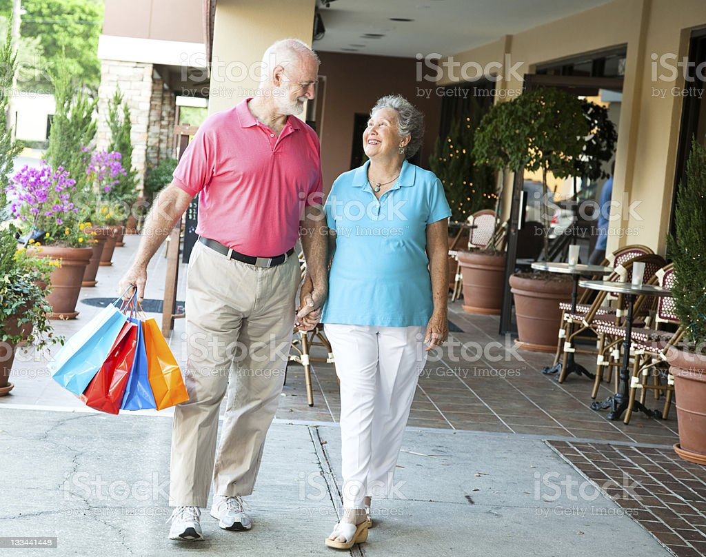 Shopping Seniors - Carrying Her Bags royalty-free stock photo