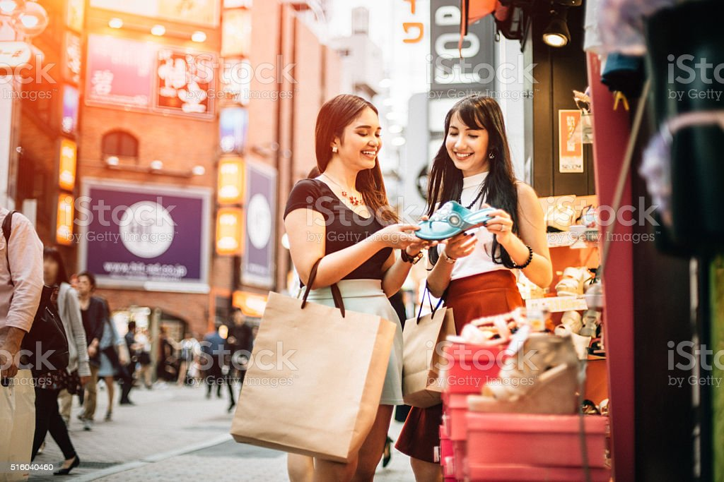 Shopping shoes with my best friend in Tokyo stock photo
