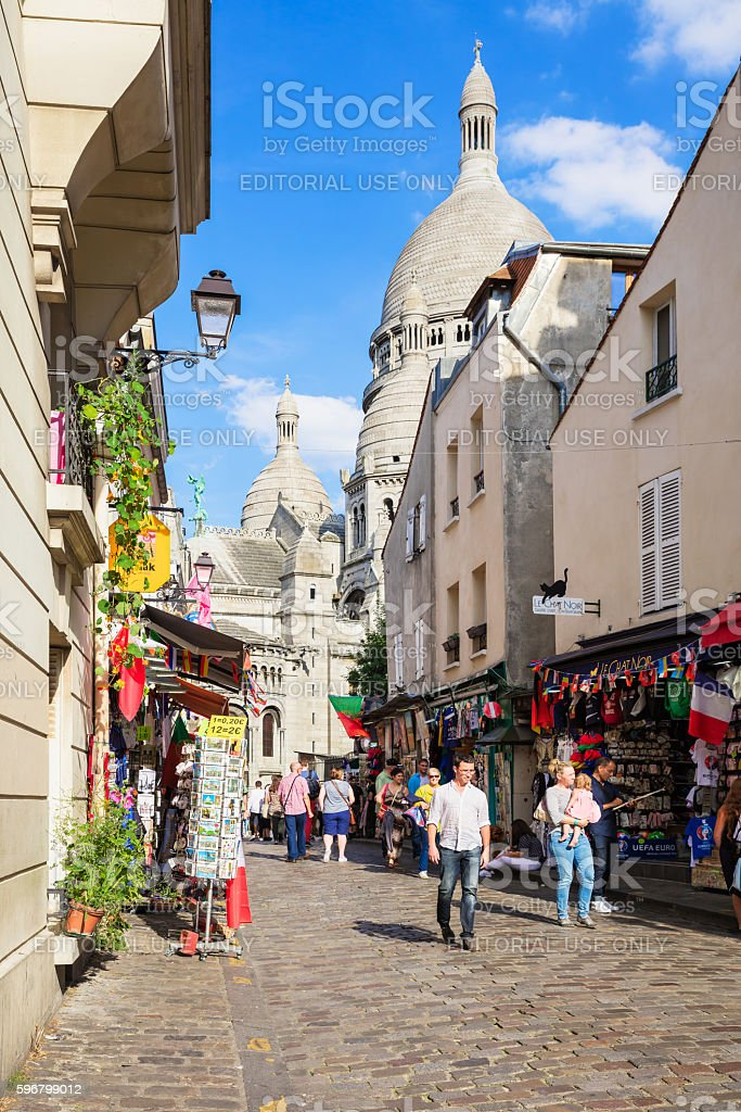 Shopping street of Montmartre near basilica Sacre Coeur. Paris, France royalty-free stock photo