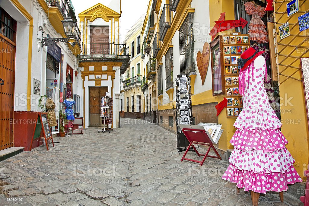 Shopping street with typical flamenco dress in Seville, Spain. royalty-free stock photo