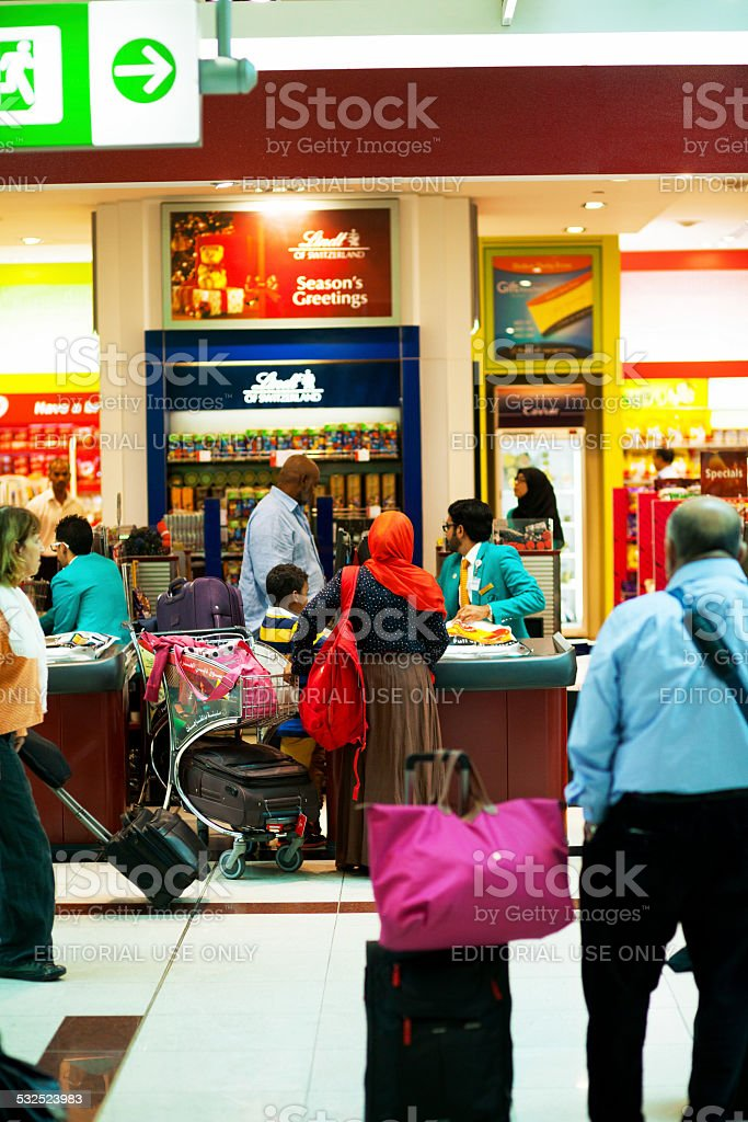 Shopping sweets at airport stock photo