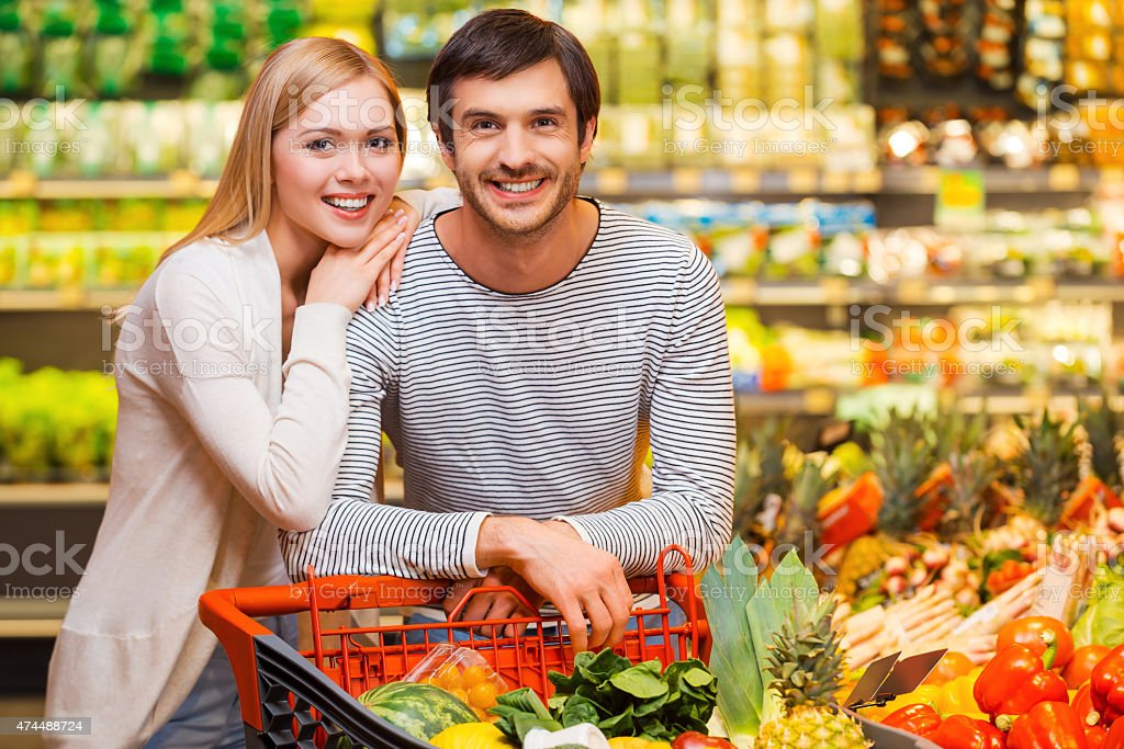 Shopping together for dinner. stock photo