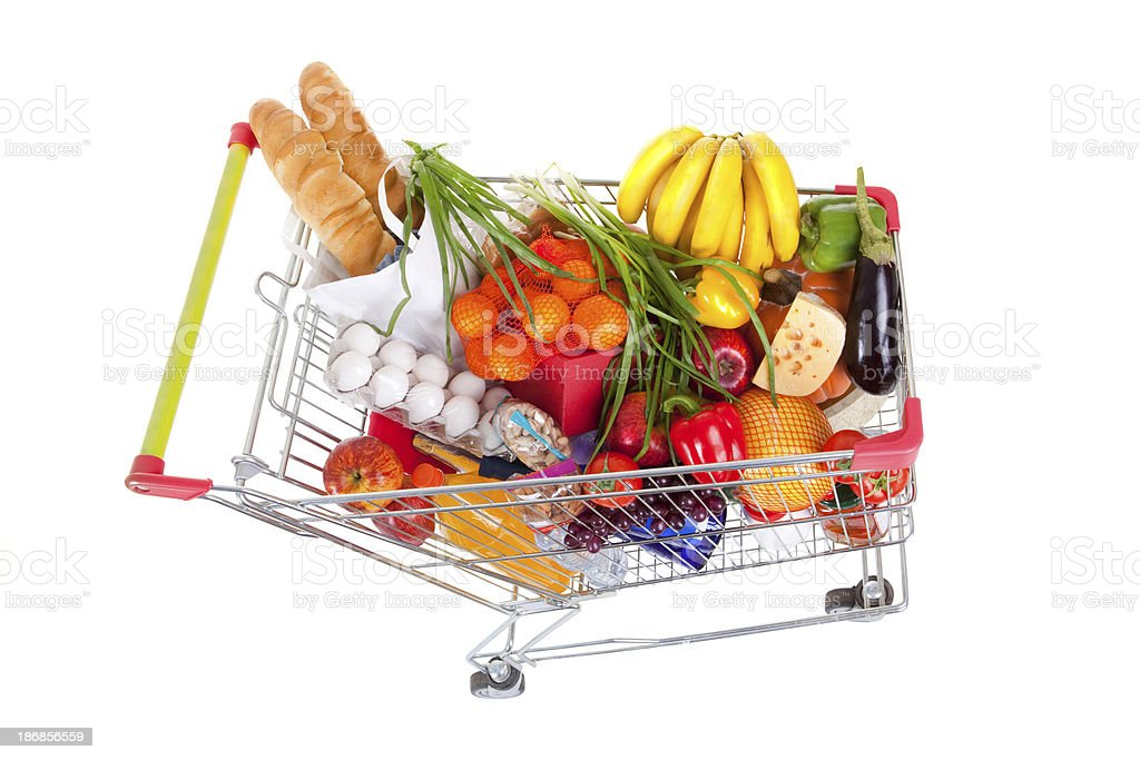 Shopping Trolley of Food on White Background. stock photo