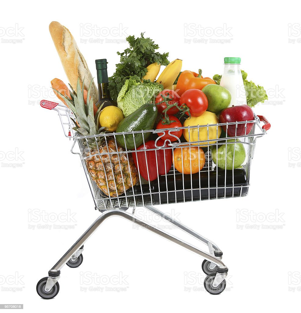 A shopping trolley overloaded with fresh food stock photo