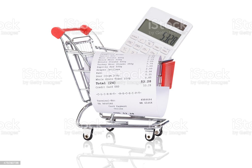 Shopping Trolley With Receipts And Calculator stock photo