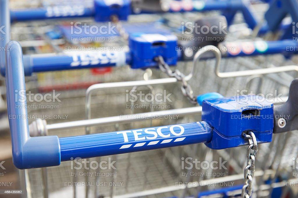 Shopping Trolleys Outside Tesco Supermarket stock photo
