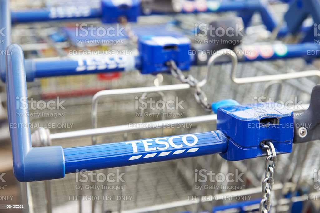 Shopping Trolleys Outside Tesco Supermarket stock photo
