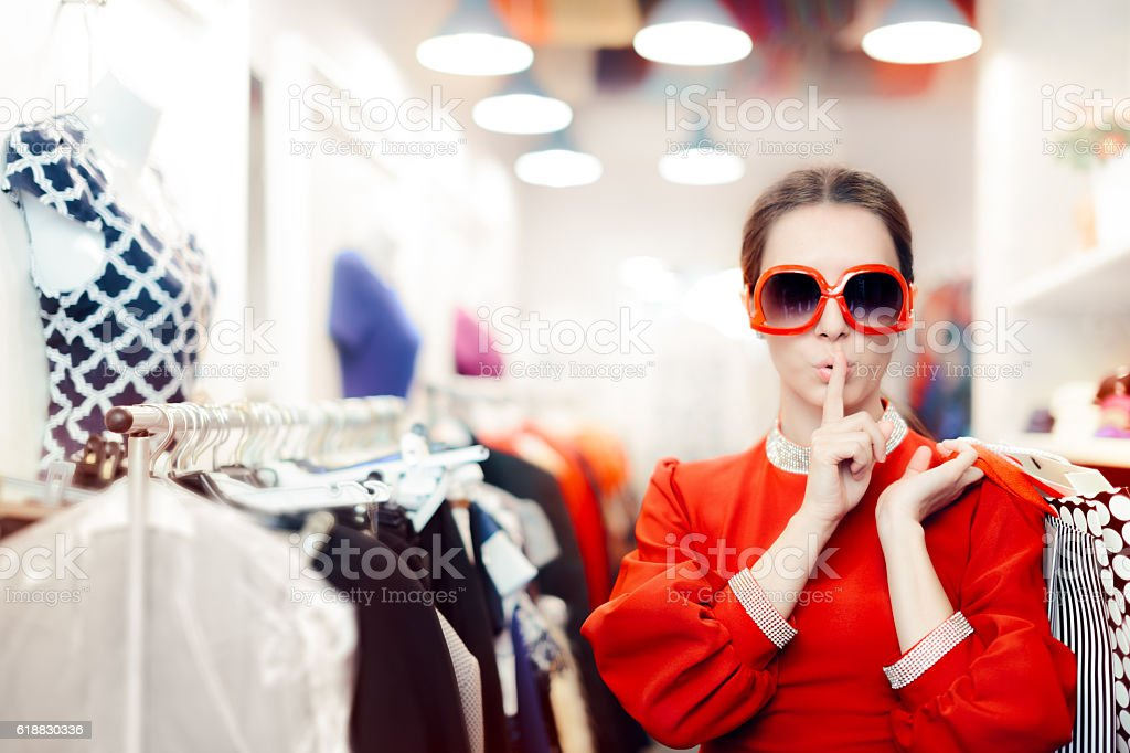 Shopping with Big Sunglasses Woman Keeping a Secret stock photo