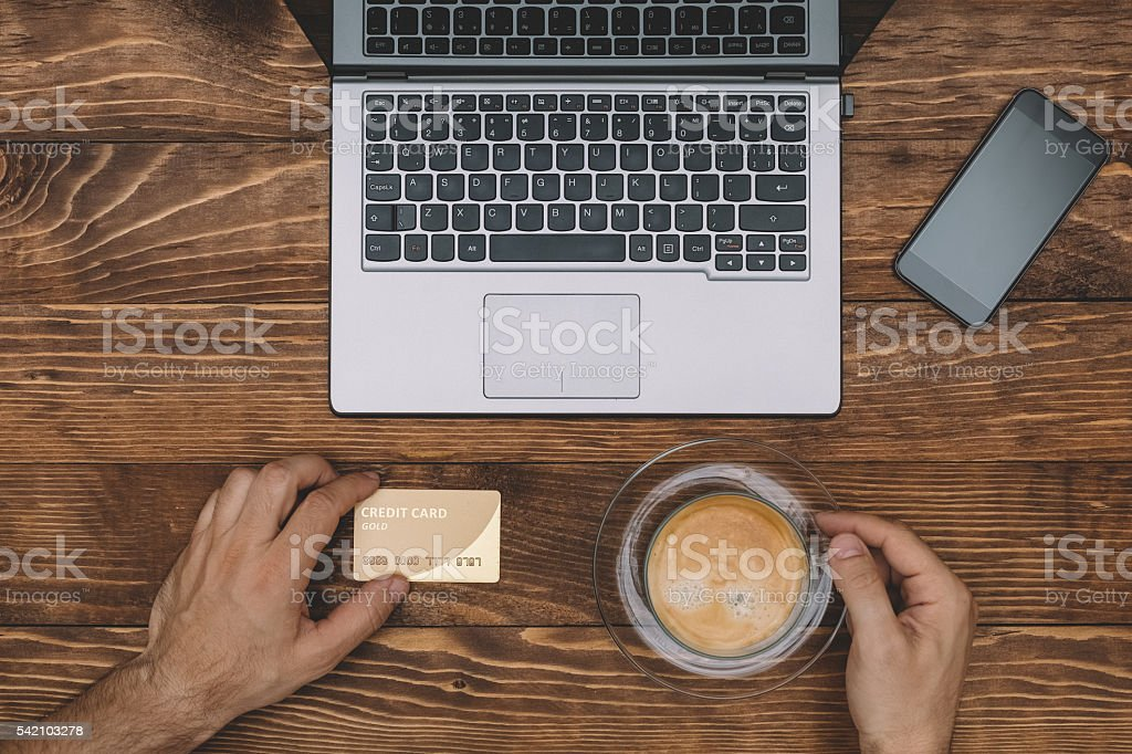 Shopping with credit card and drinking coffee stock photo