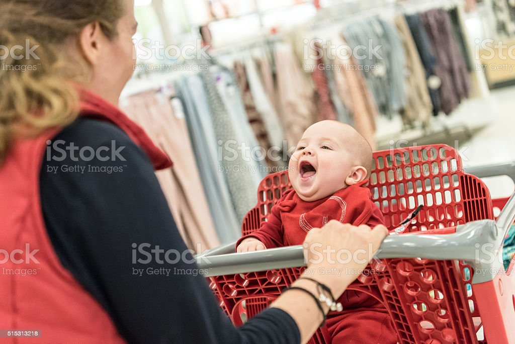 Shopping with her baby stock photo