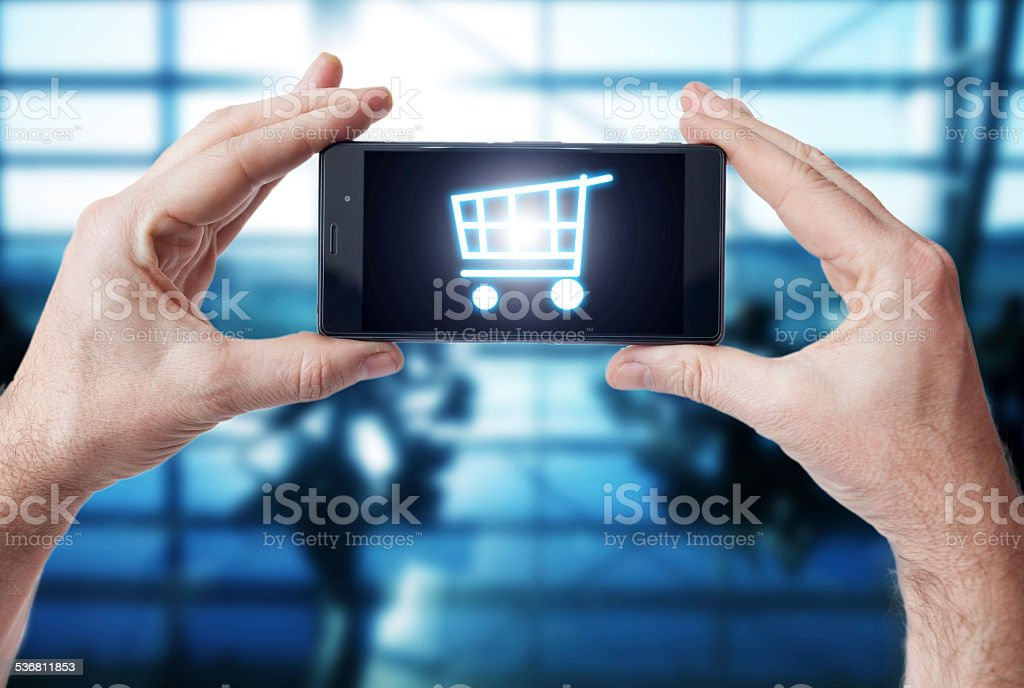 Shopping with mobile phone stock photo