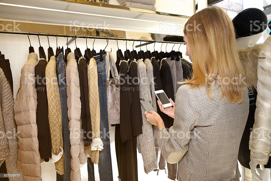 Shopping with QR Code, NYC. stock photo
