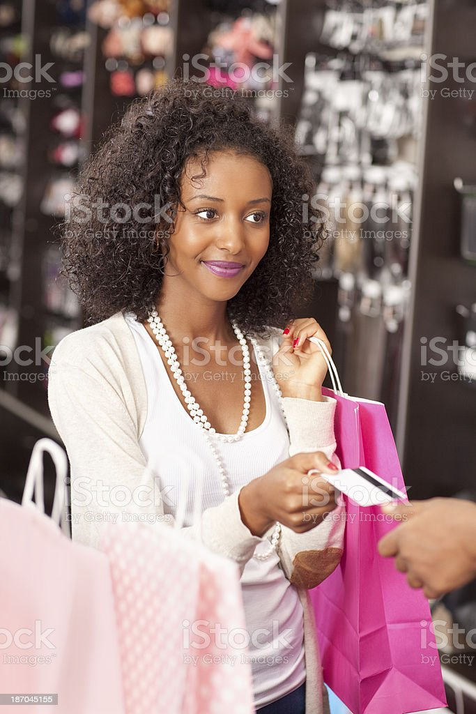 Shopping woman at the checkout paying by credit card. royalty-free stock photo