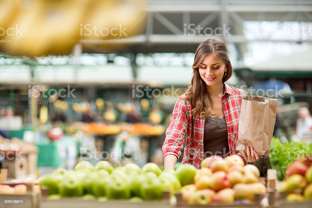 shopping woman buying at the market stock photo