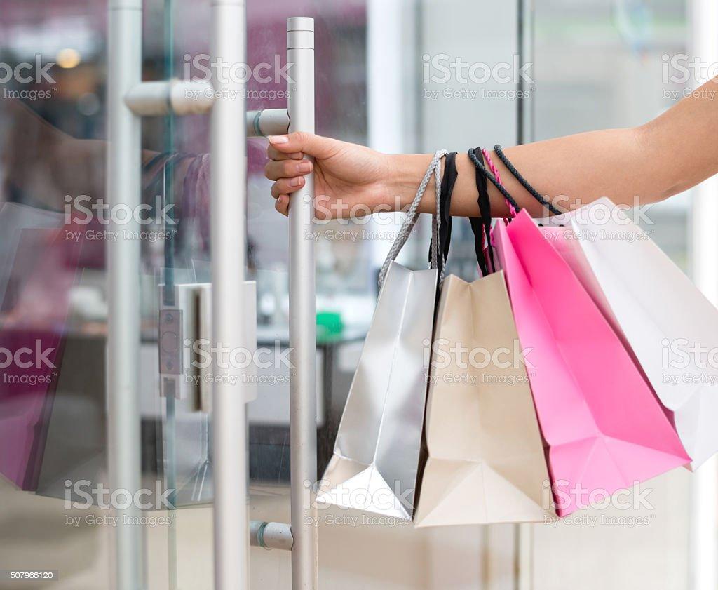Shopping woman entering a store stock photo