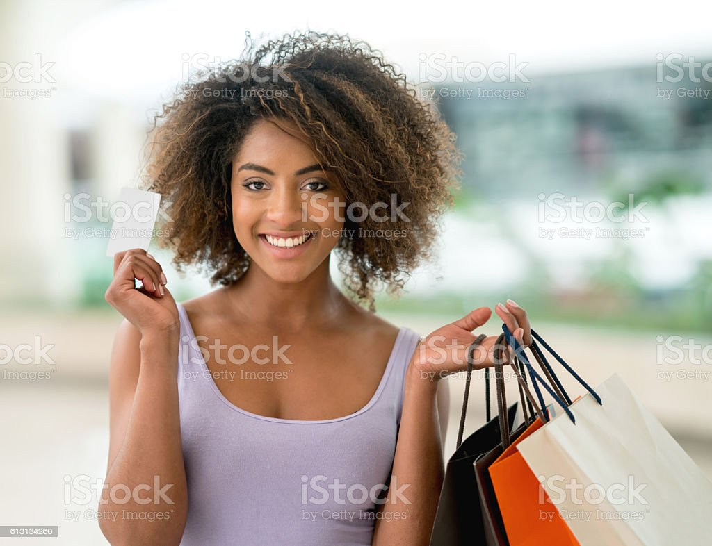 Shopping woman holding a credit card stock photo