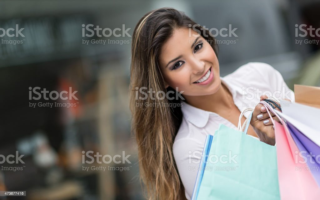 Shopping woman holding bags at the mall stock photo