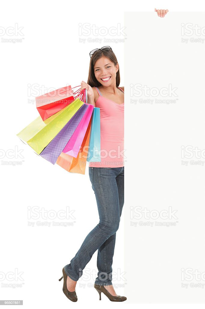 Shopping woman holding blank commercial sign royalty-free stock photo