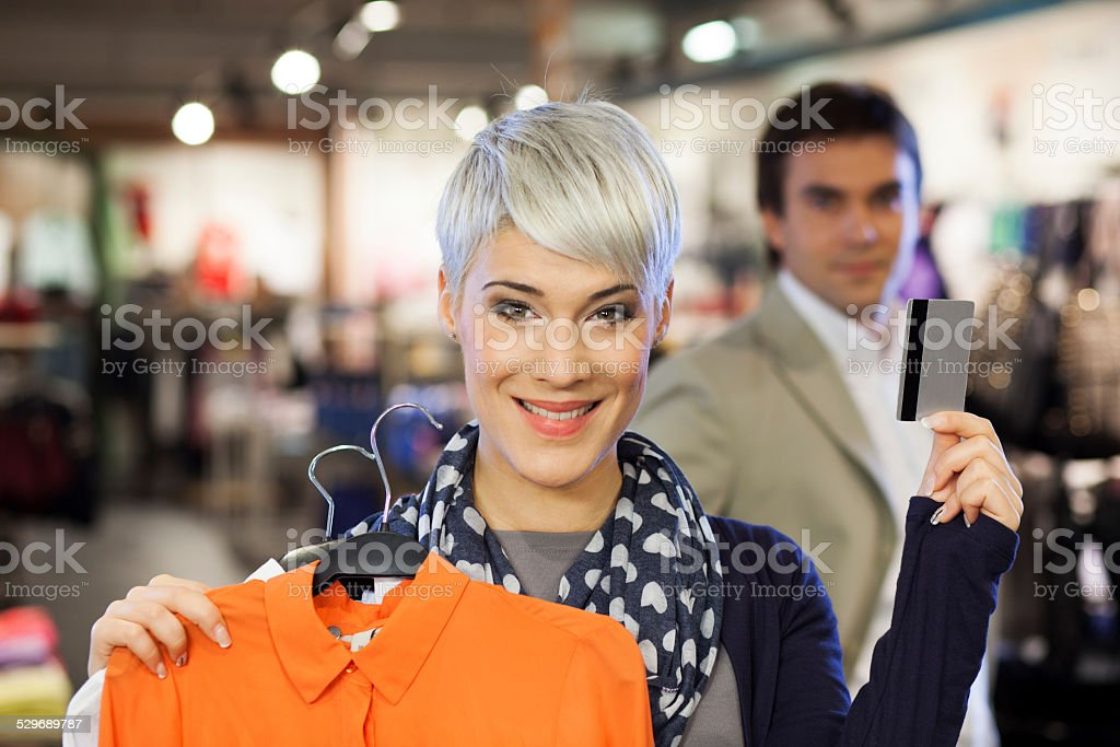 Shopping woman holding credit card stock photo