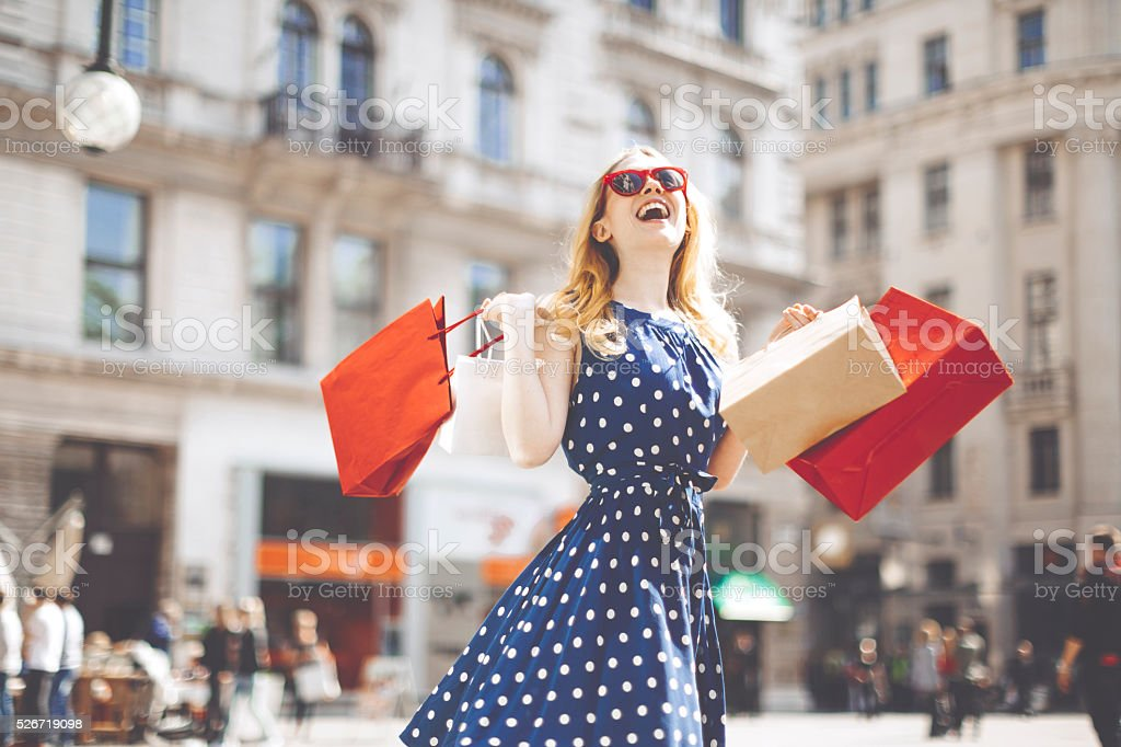 Shopping woman in the city stock photo
