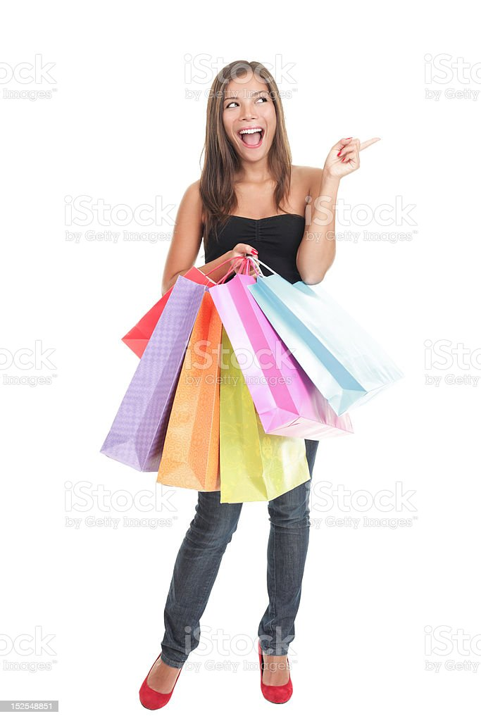 Shopping woman isolated - pointing excited royalty-free stock photo