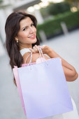 Shopping woman on the street with bags