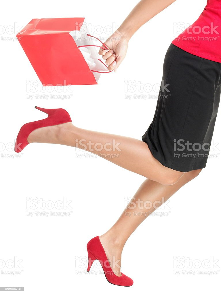 Shopping woman running holding bag stock photo