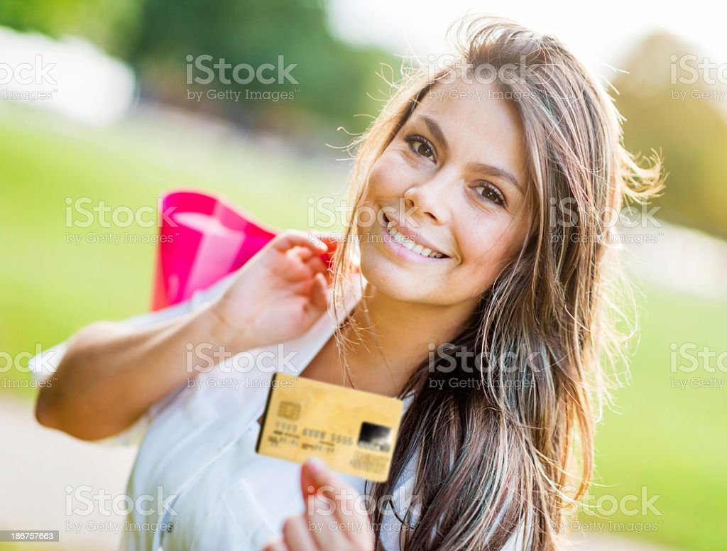 Shopping woman with a credit card royalty-free stock photo