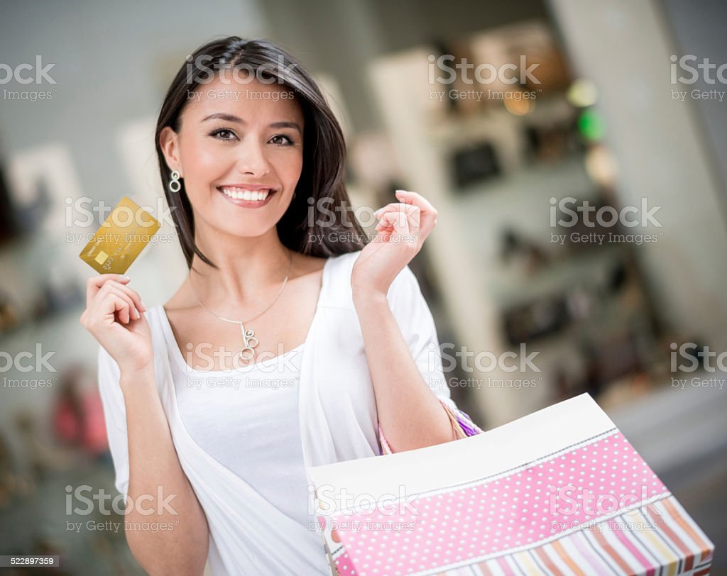 Shopping woman with a credit card stock photo