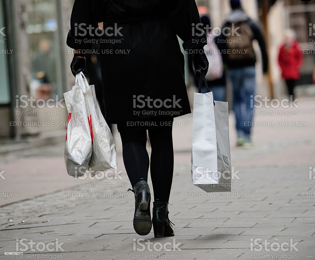 Shopping woman with bags on street stock photo