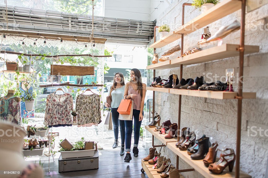 Shopping women at a clothing store stock photo