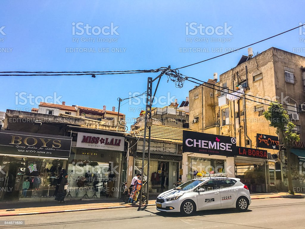 Shops and taxi in Bnei Brak, Israel stock photo
