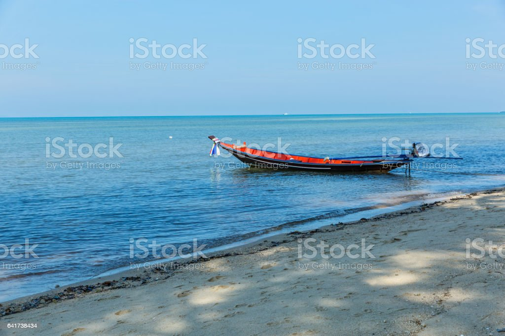 Shore and boat stock photo
